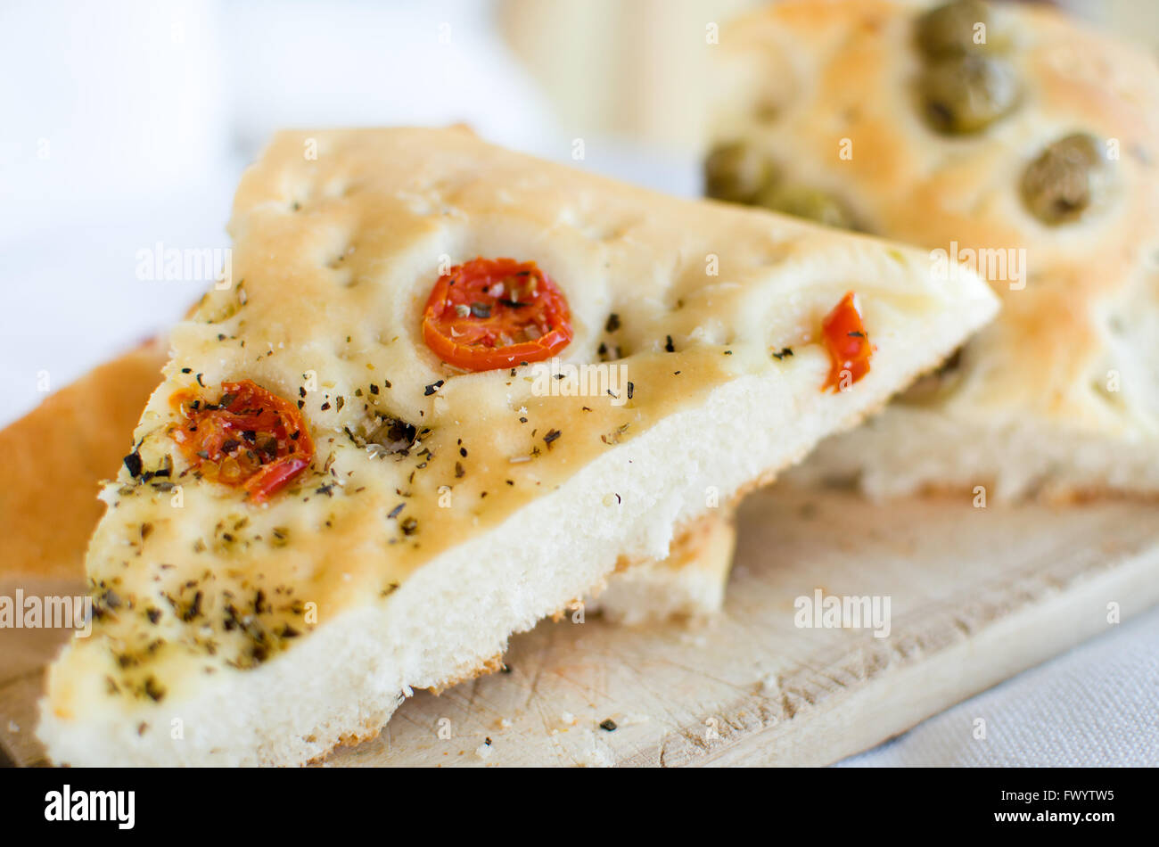 flatbread italy focaccia tomatoes olives flat oven baked Italian bread genovese ligure Stock Photo