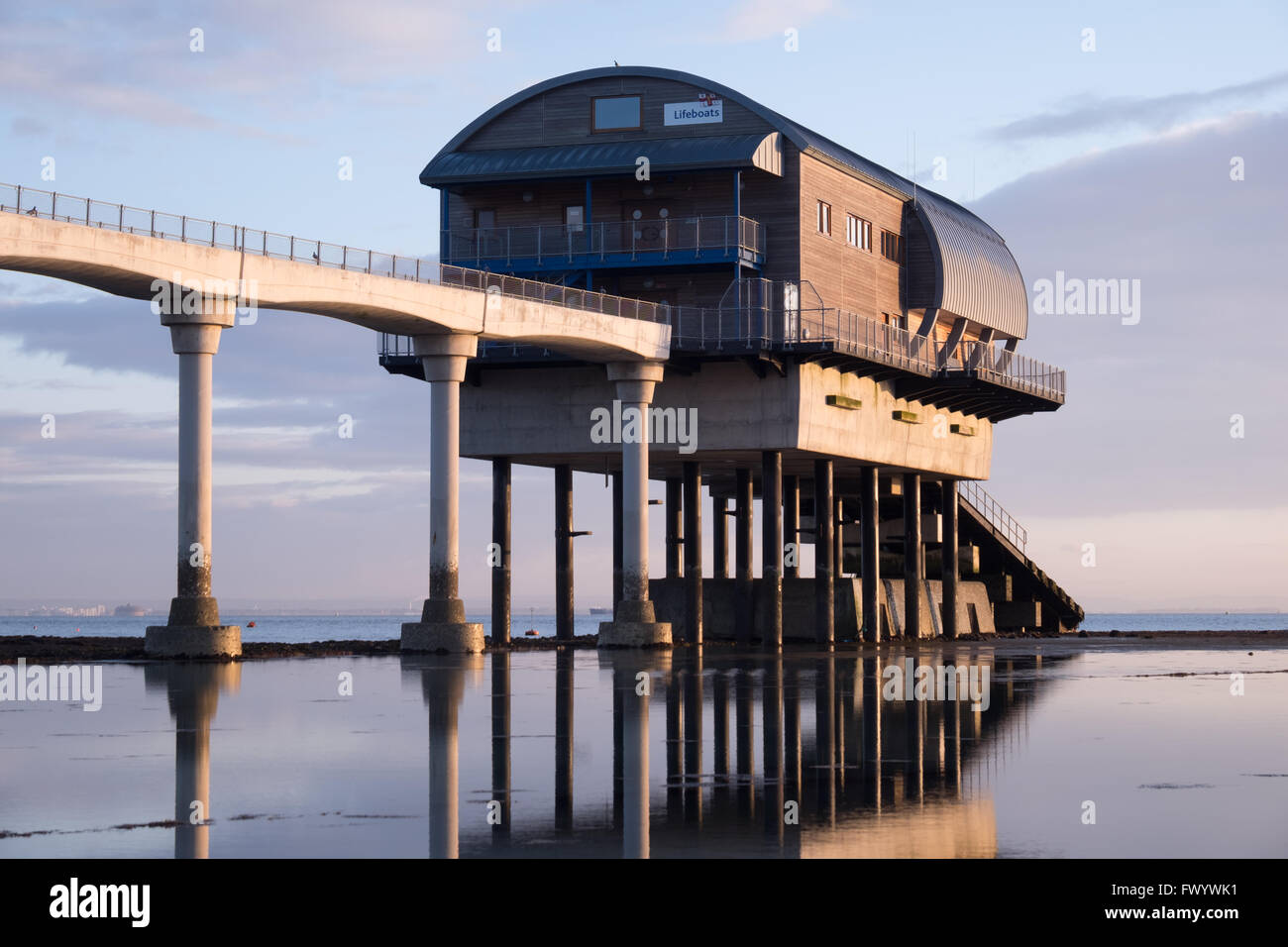 Early morning sun shines on the RNLI lifeboat station in Bembridge on the Isle of Wight - Stock Image