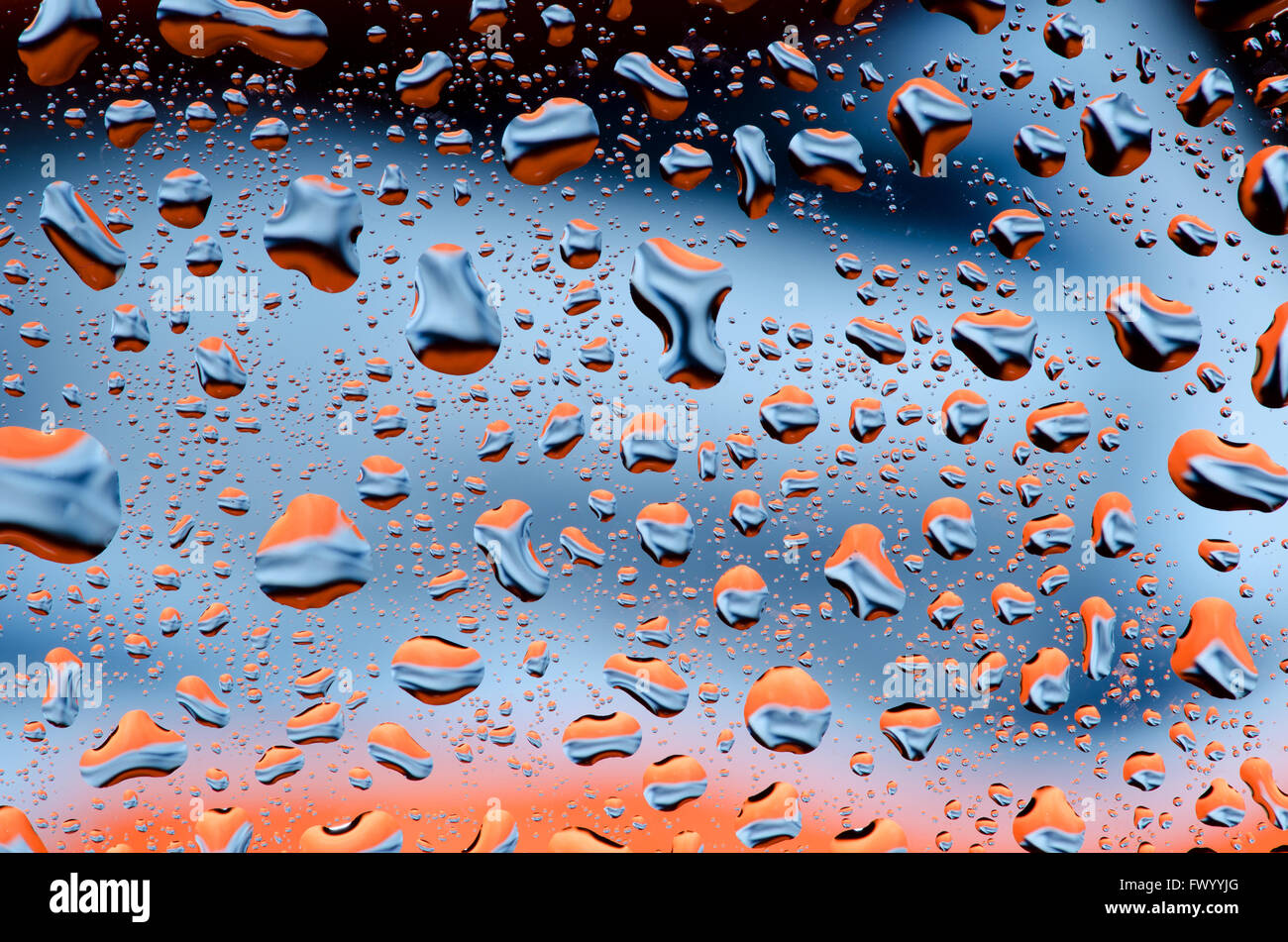 Black blue orange background with water drops pattern. - Stock Image