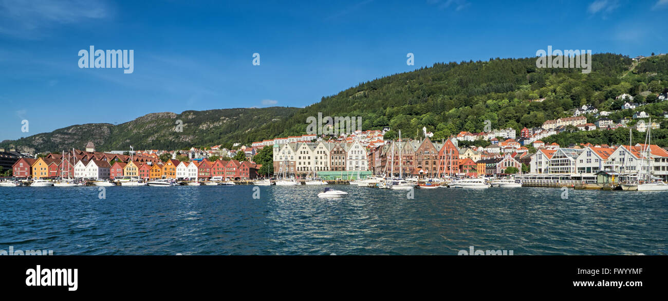 Attrtractive shoreline: Bryggen, Bergen, Norway with historic wood houses and boats - Stock Image