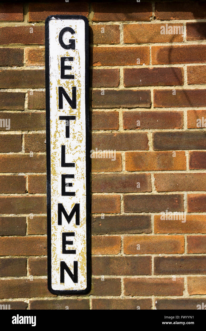 A vertical Gentlemen sign on public toilets in England. - Stock Image