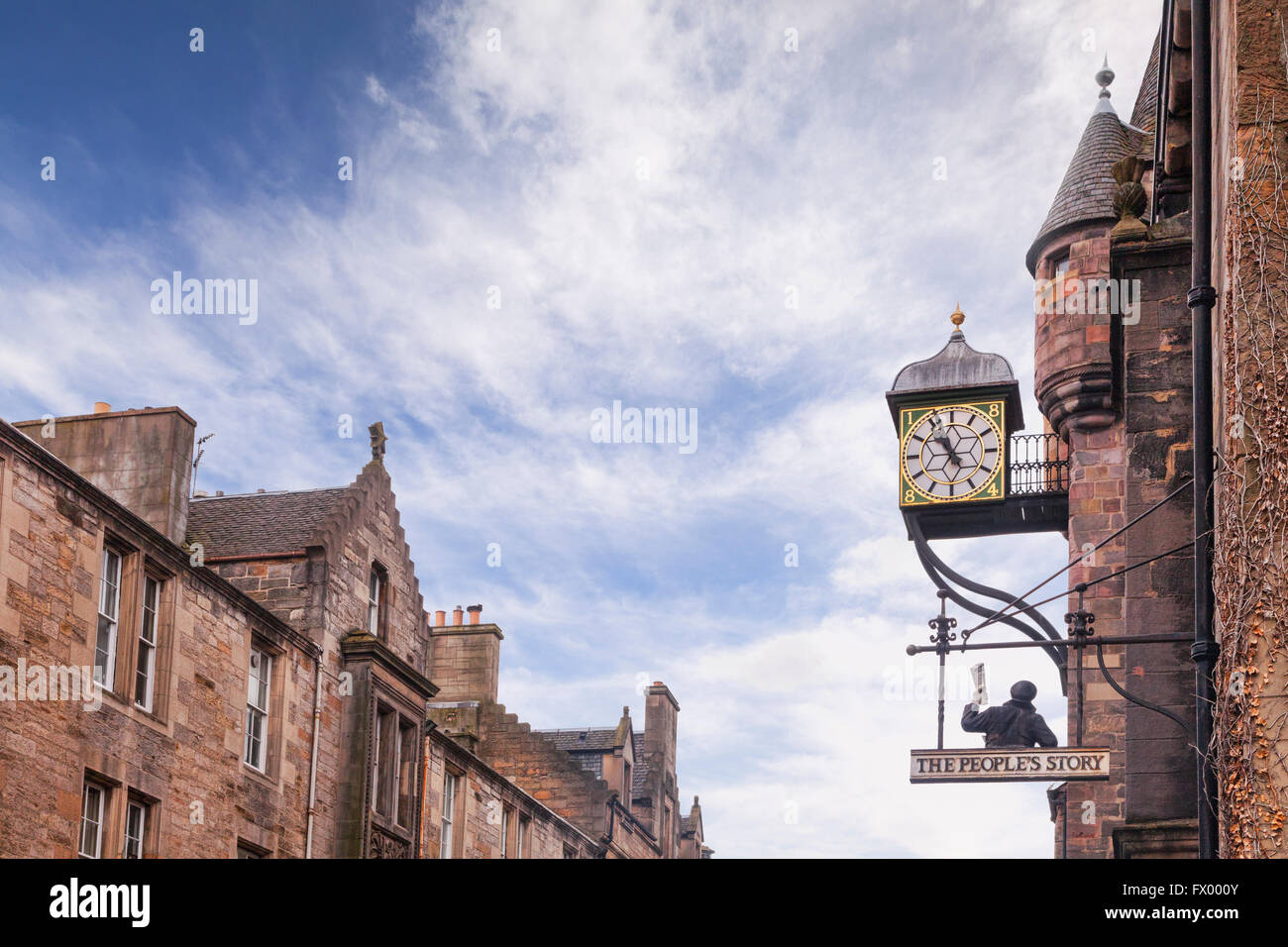Royal Mile skyline, and the clock at the Tolbooth Tavern, in the Old Town, Edinburgh, Scotland, UK - Stock Image