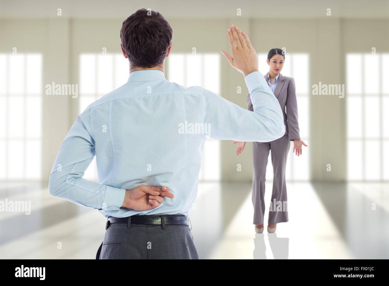 Composite image of businessman crossing fingers behind his back - Stock Image