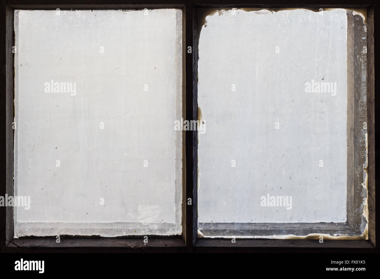 Dirty and opaque window glasses and old wooden frames. - Stock Image
