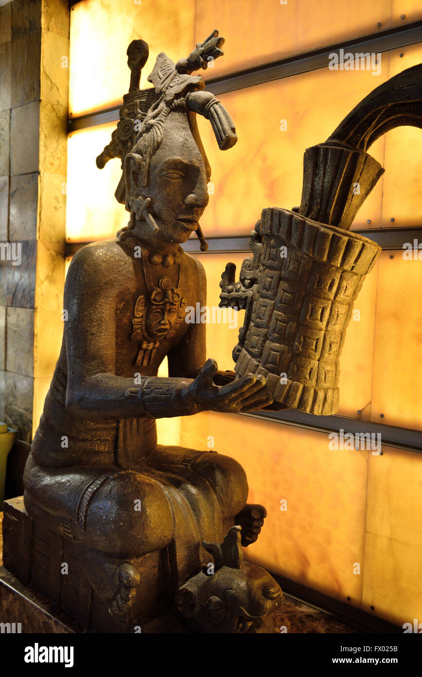 Statue of a Mayan priest offering gifts in Grand Palace hotel Nuevo Vallarta Mexico - Stock Image