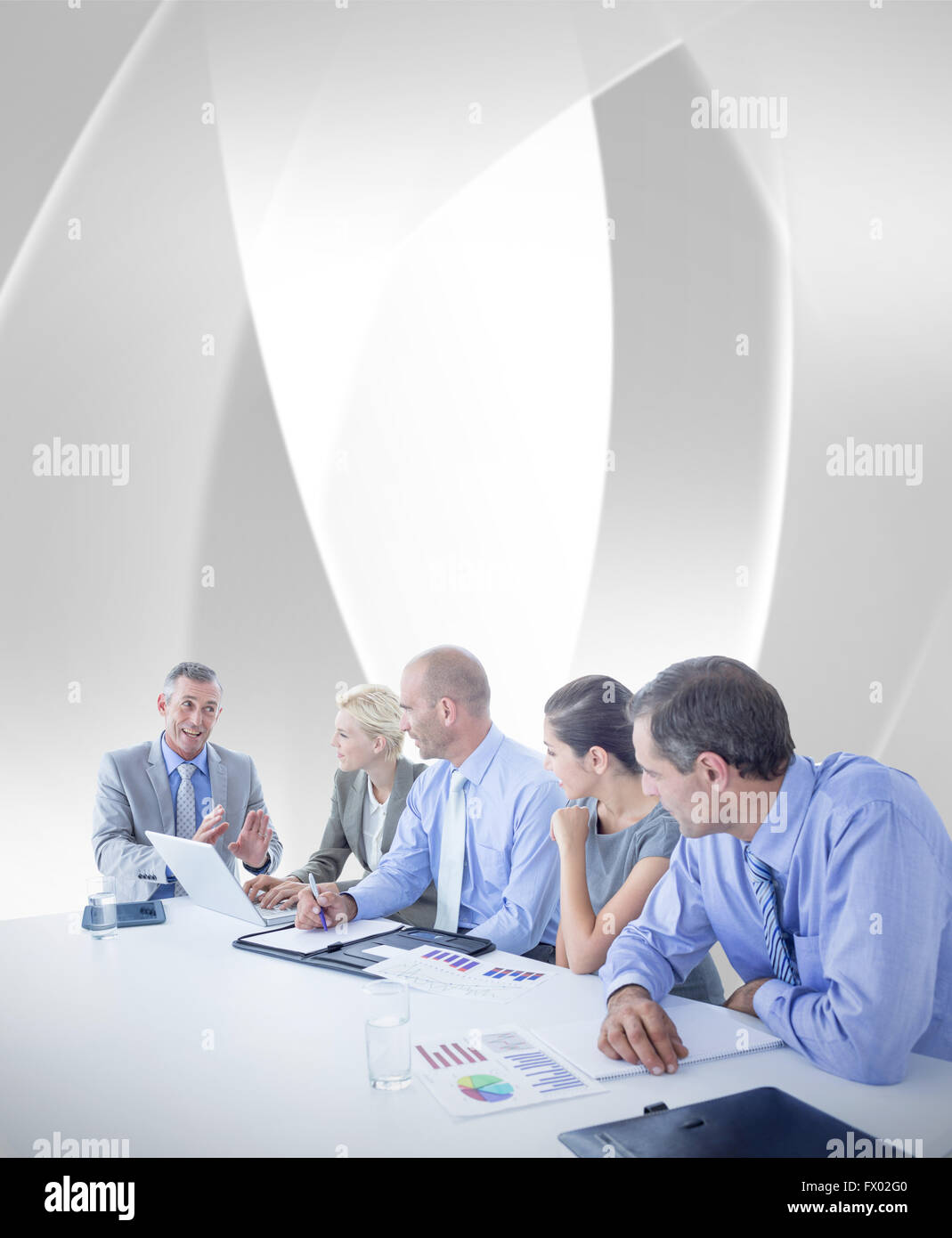 Composite image of business team having a meeting Stock Photo