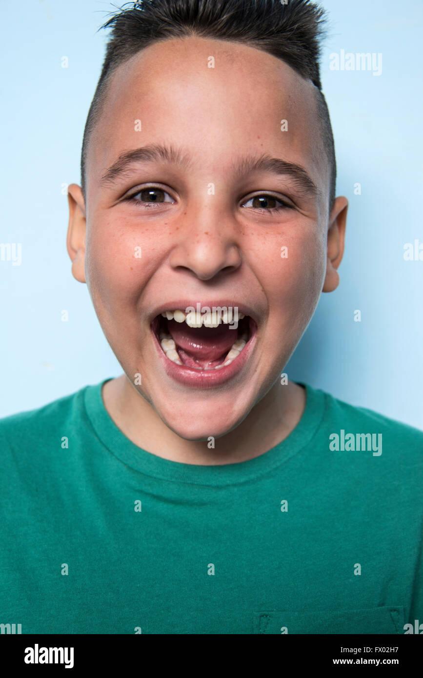 Portrait of excited Latin boy - Stock Image
