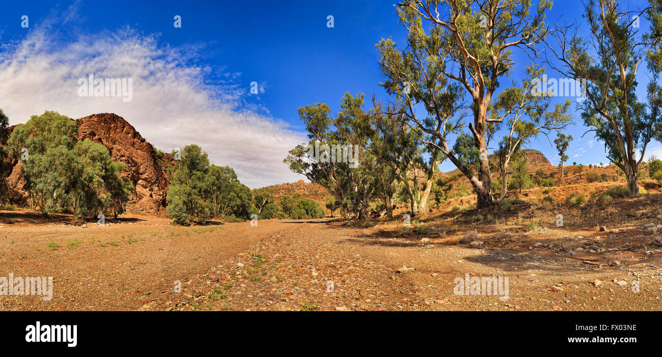 Gravel 4wd road on a dry riverbed through the bottom of Brachina gorge in Flinders Ranges national park, South Australia. - Stock Image