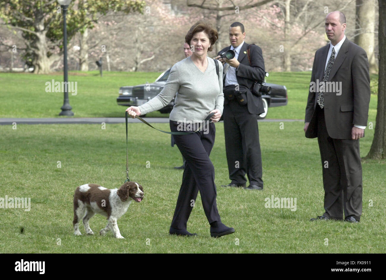 First Lady Laura Bush Walks Her Dog Spot Across The South Lawn Of