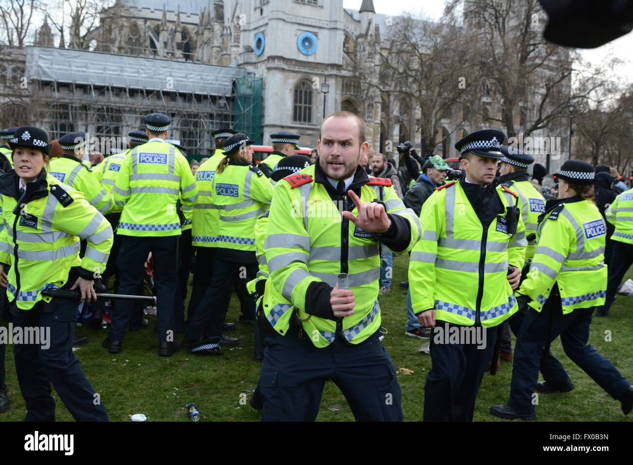 London, UK. 9th April 2016. Police officer prepares to deploy CS spray.Police clash with protesters in Parliament - Stock Image