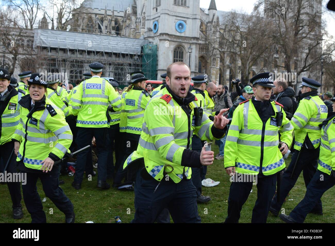 London, UK. 9th April 2016. Police officer draws CS spray and warns crowd back.Police clash with protesters in Parliament - Stock Image