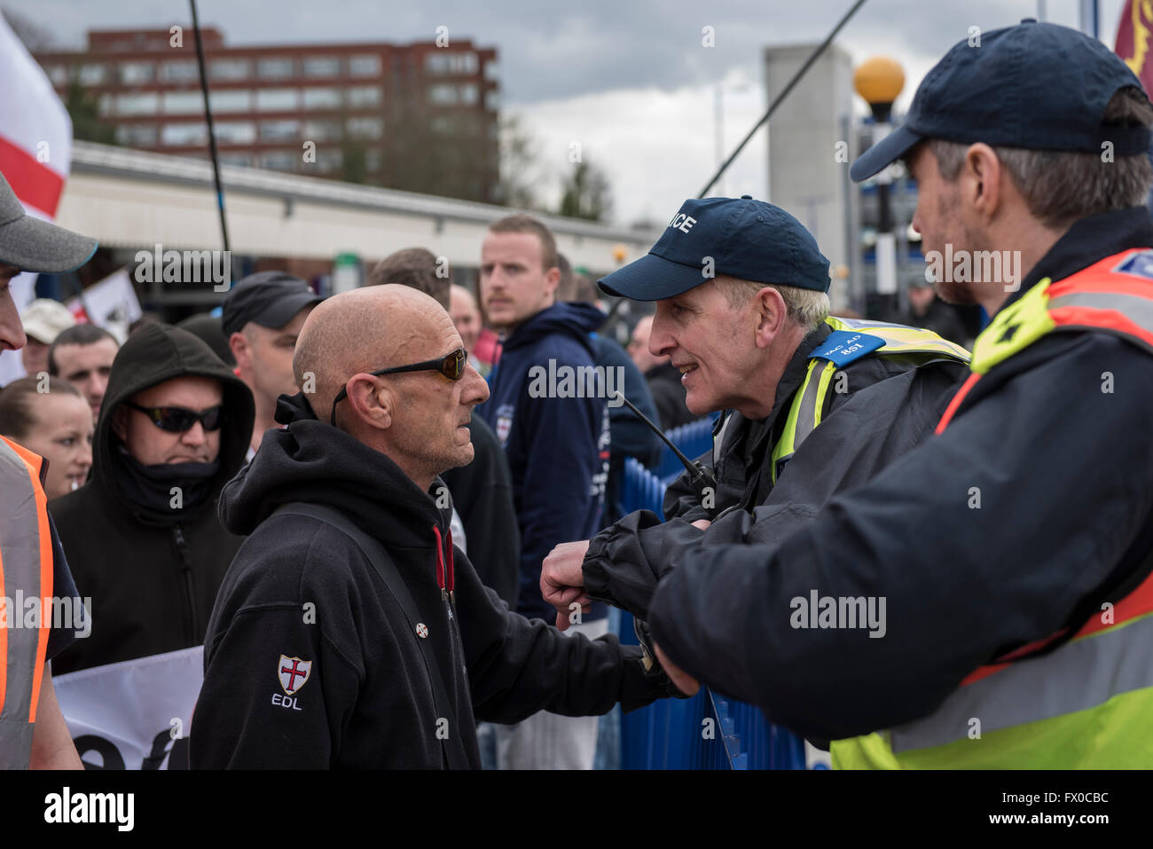High Wycombe, Buckinghamshire, UK. 9th April 2016. An EDL supporter is warned by Police for wearing a face mask. - Stock Image