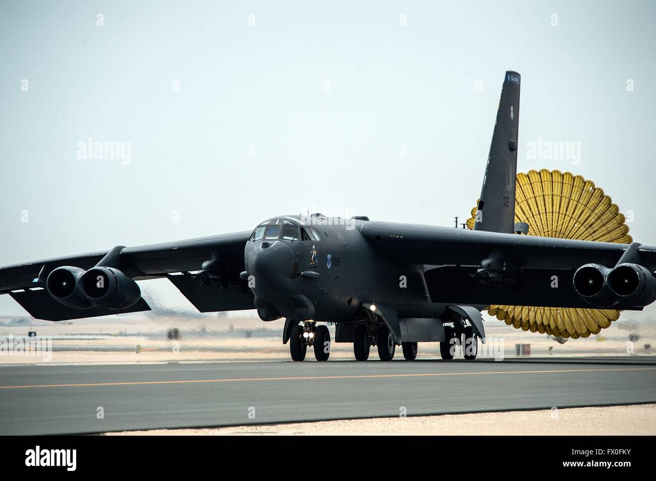 A U.S. Air Force B-52H Stratofortress strategic bomber lands at Al Udeid Air Base April 9, 2016 in Qatar. The aircraft - Stock Image