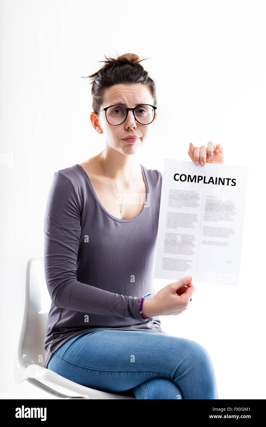 sad r worried woman with glasses sending complaints to you - Stock Image