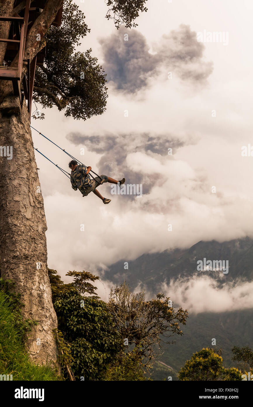 Banos De Agua Santa,  - 08 March 2016: Happy Adult Caucasian Man Swinging On A Swing In Banos De Agua Santa, Tungurahua - Stock Image