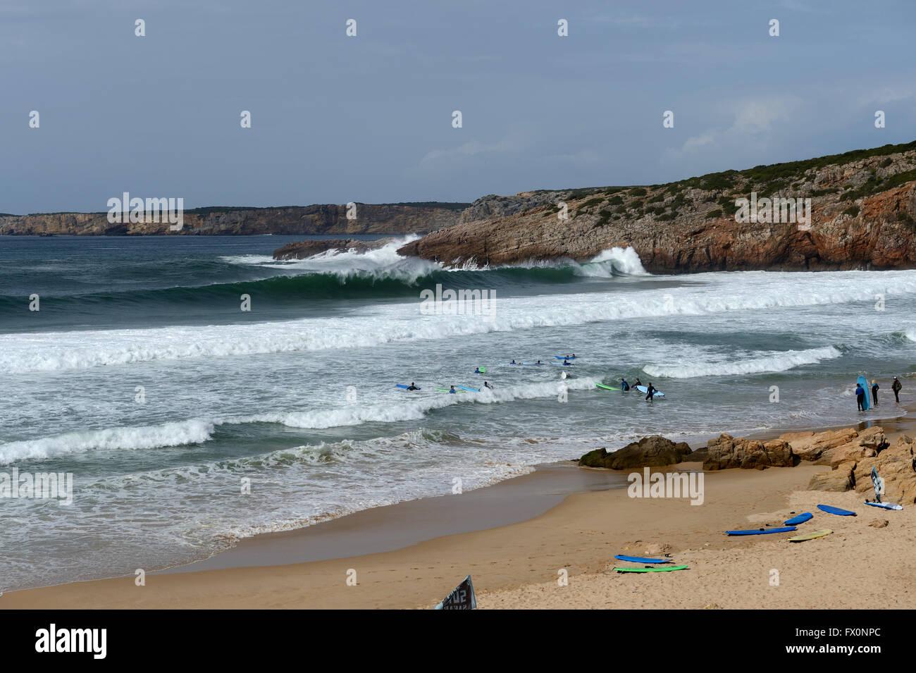 surf school in the shallows praia do Zavial - Stock Image