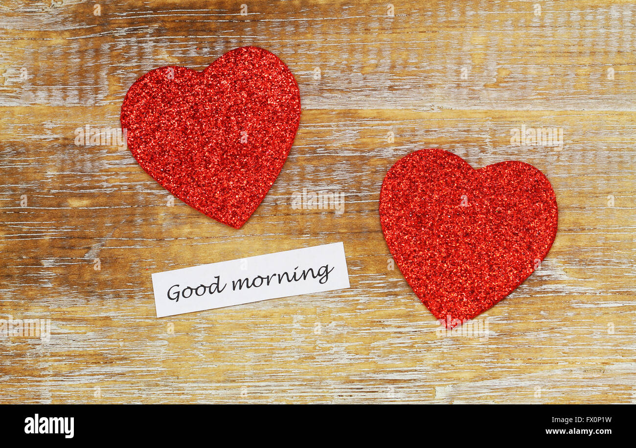 Good Morning Card With Two Sparkling Hearts On Rustic Wooden Surface