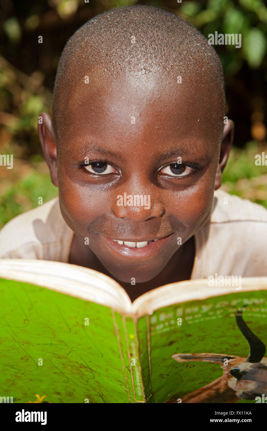 Smiling Rwandan children reading school books. Rwanda. - Stock Image