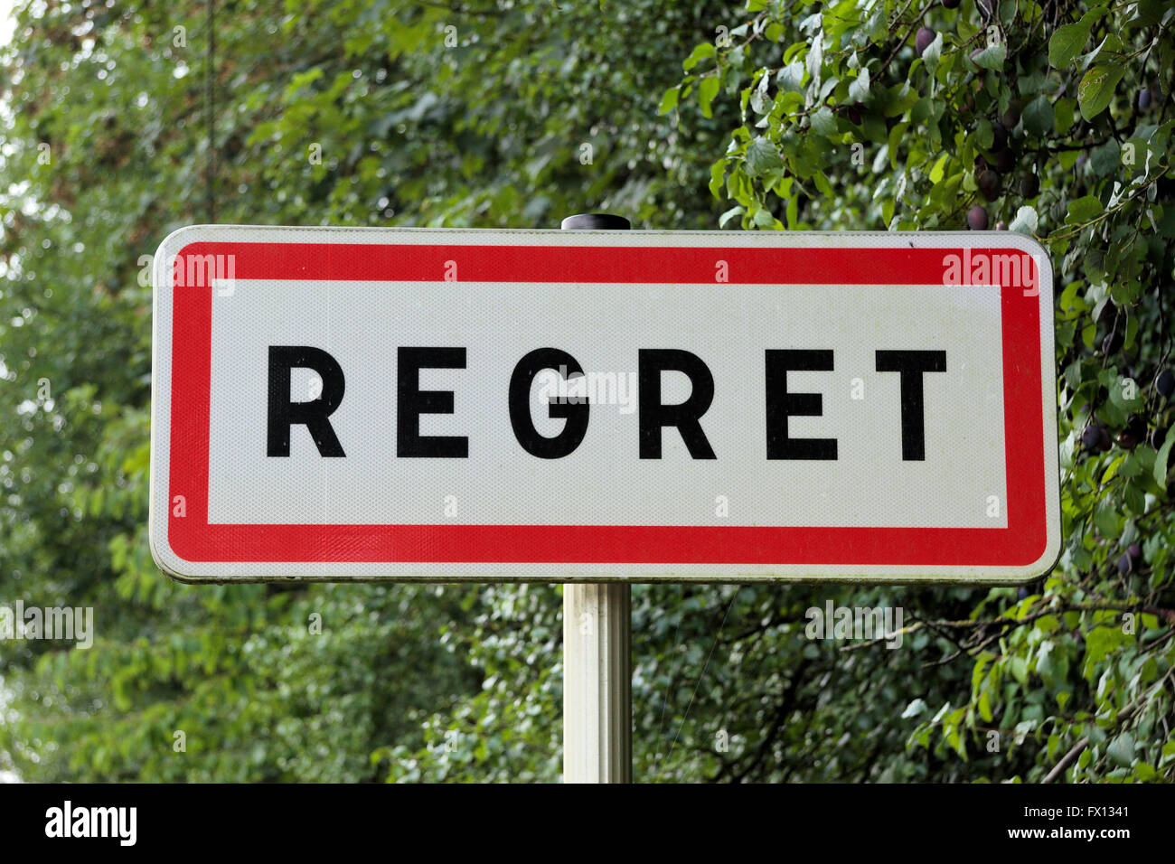Road sign for the French village of Regret, Verdun, France. - Stock Image