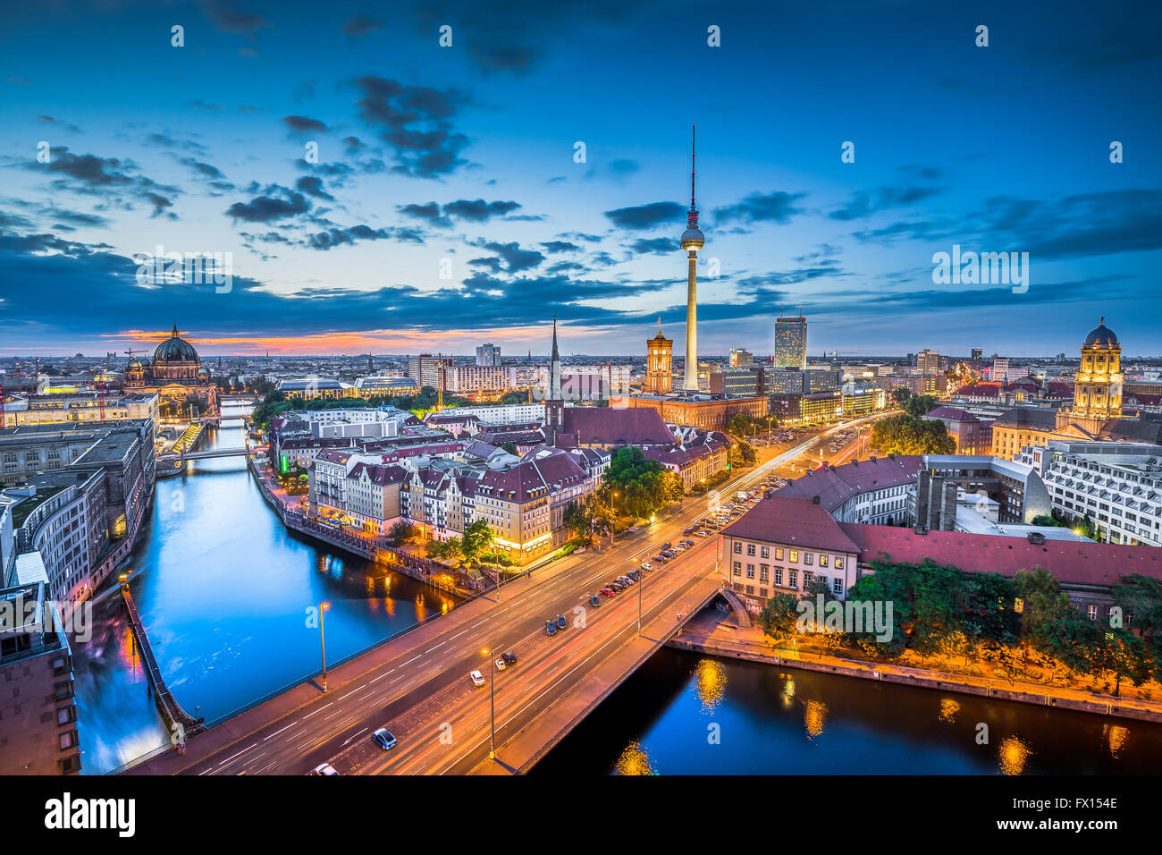Aerial view of Berlin skyline with dramatic clouds in twilight during blue hour at dusk, Germany - Stock Image