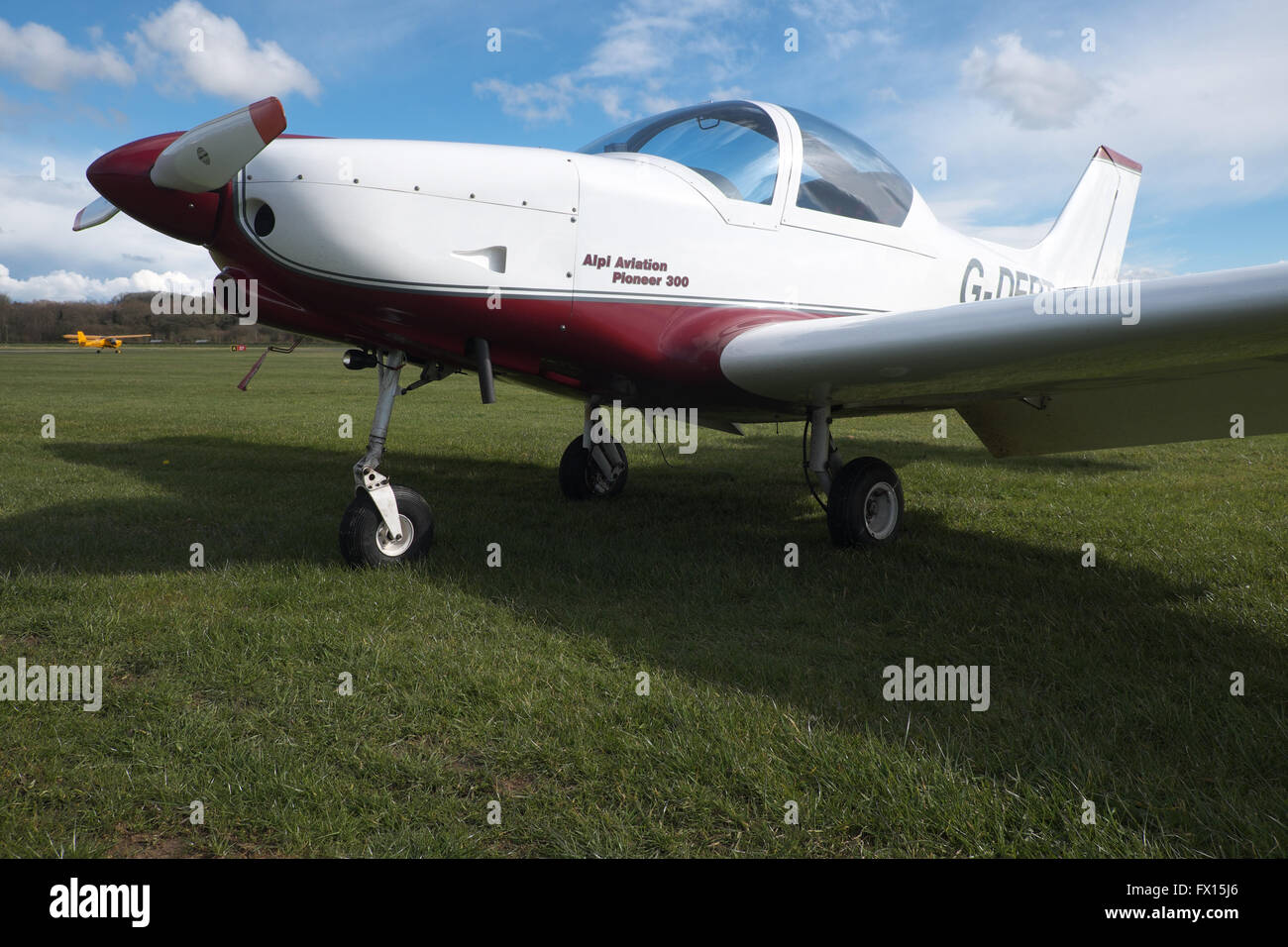 Alpi Aviation Pioneer 300 light aircraft at a grass airfield in the UK - Stock Image