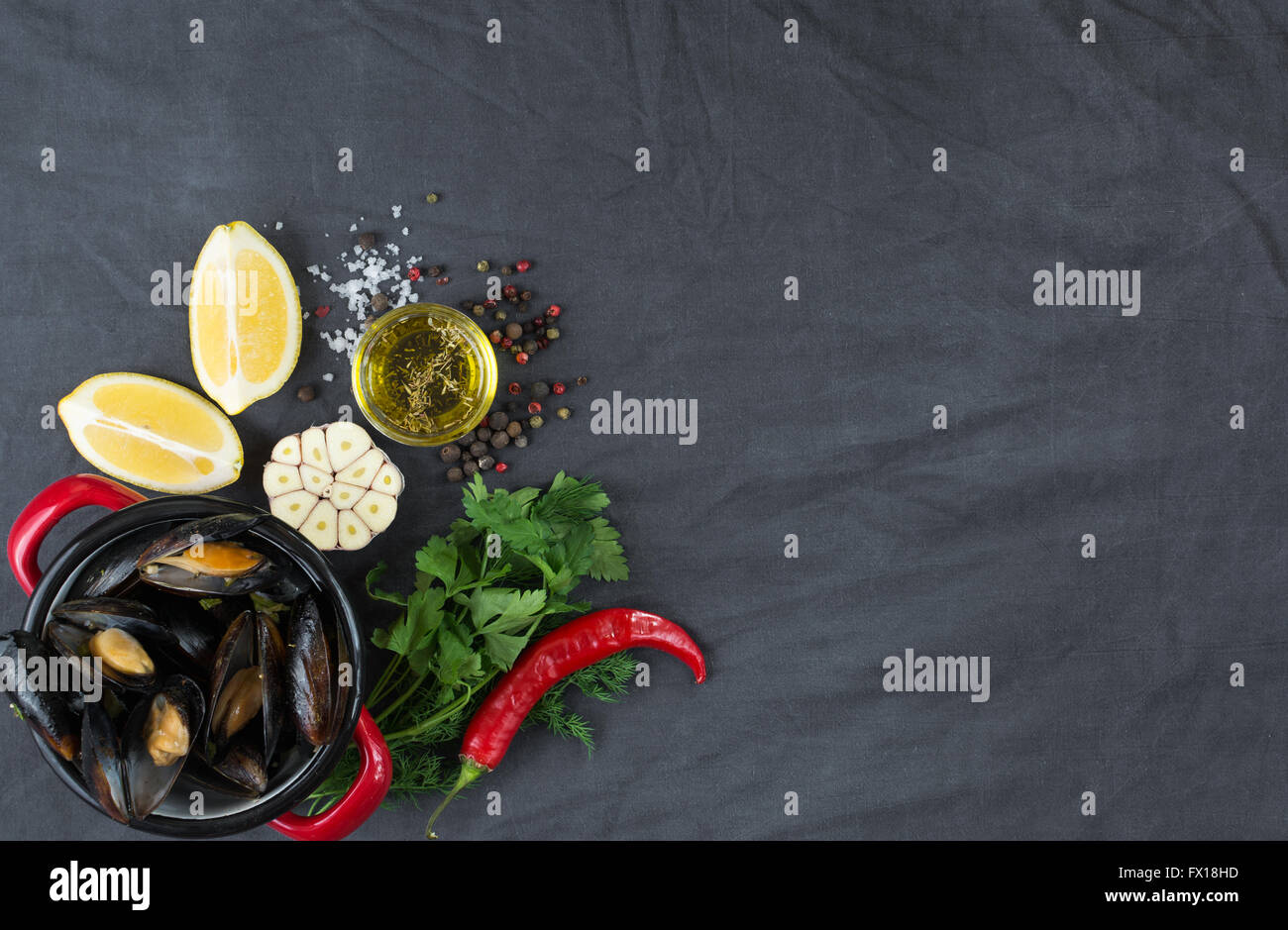 Casserole with mussels, lemons, chili pepper and spices - Stock Image