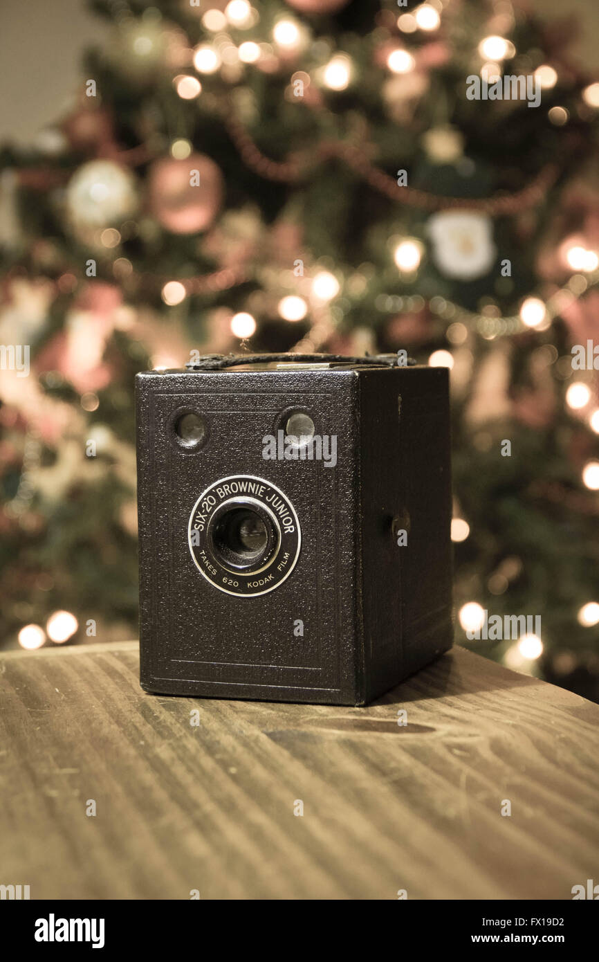 Old Kodak Camera with a christmas tree in background - Stock Image