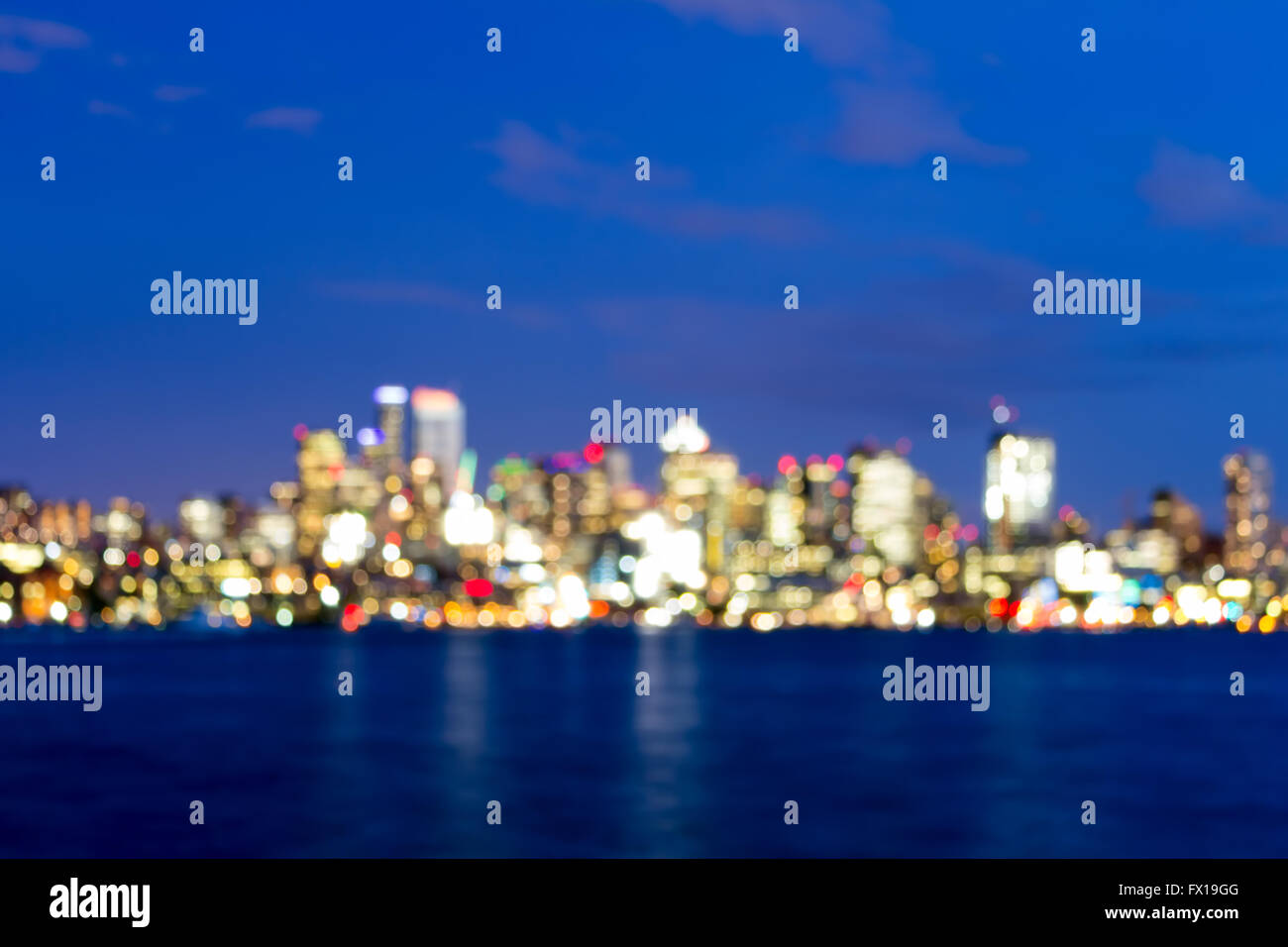 Seattle Washington city skyline along Lake Union at evening blue hour blurred defocused bokeh - Stock Image