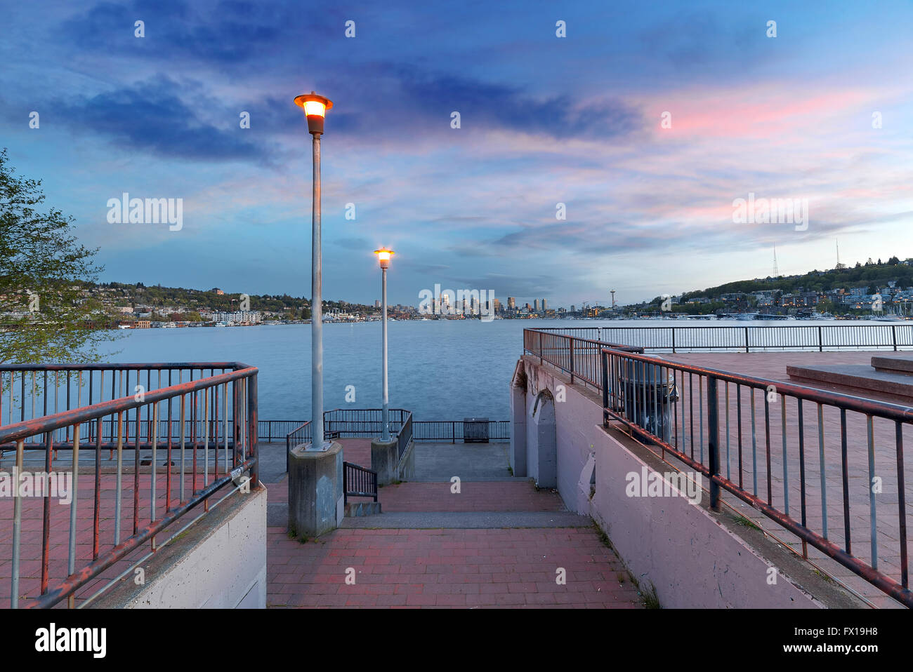 Gas Works Park with city skyline along Lake Union in Seattle Washington after sunset - Stock Image