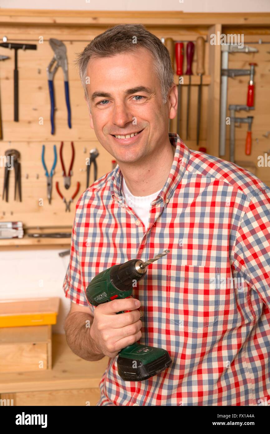 Do-it-yourselfer with a drill, portrait - Stock Image