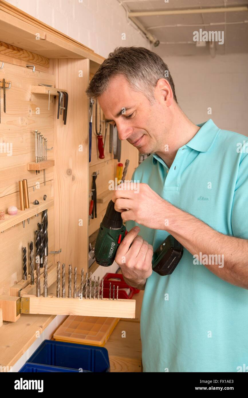 Do-it-yourselfer searches suitable tools - Stock Image