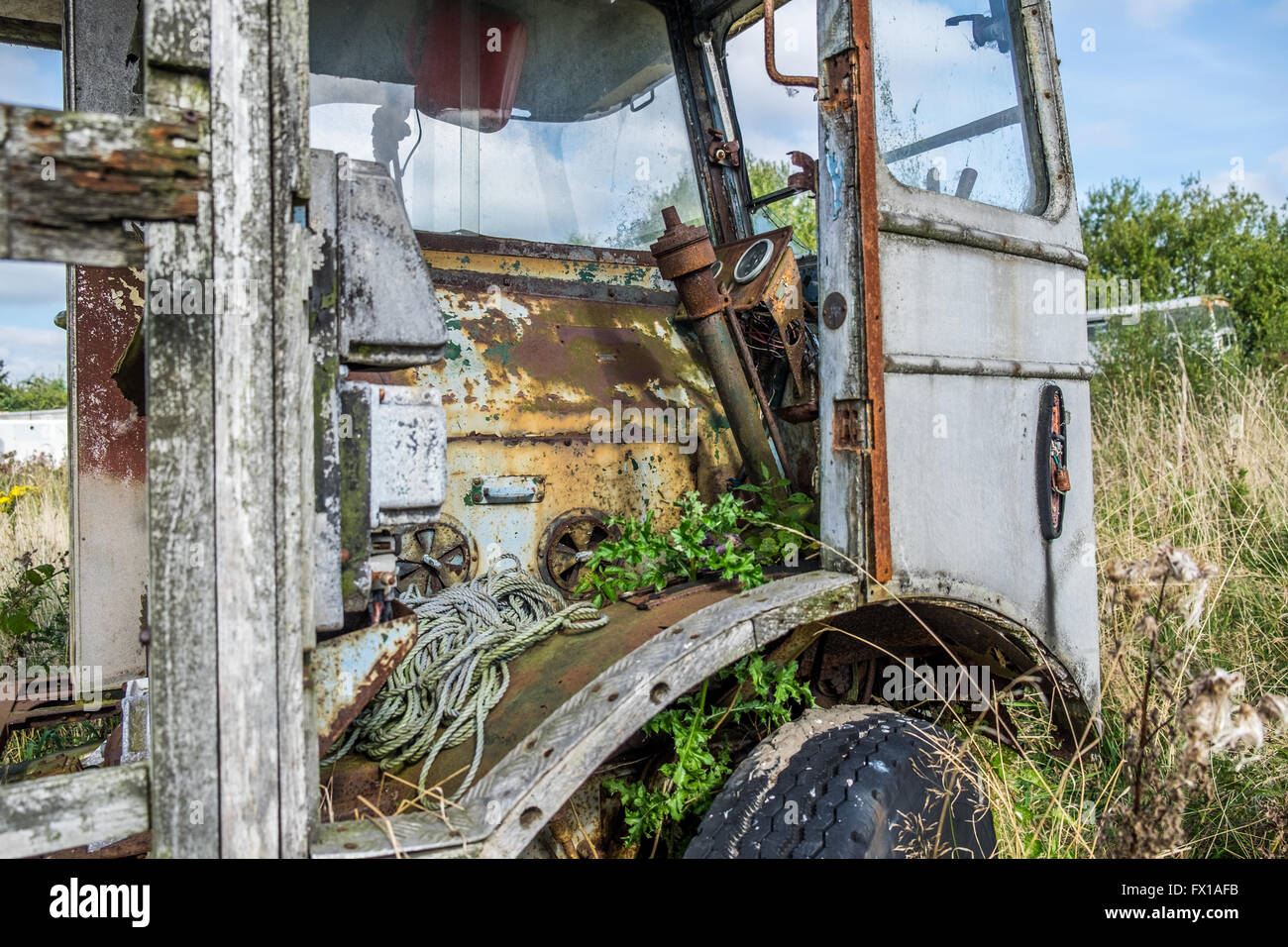 Old coach body abandoned and left to rot in a farmers field. - Stock Image