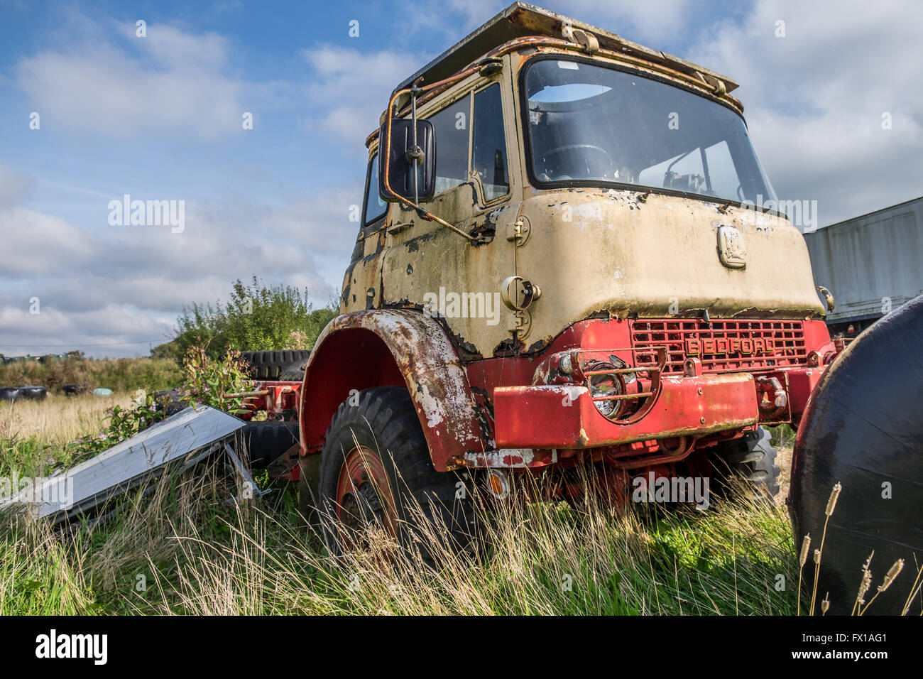 Old Bedford truck abandoned and left to rot in a farmers field. Stock Photo