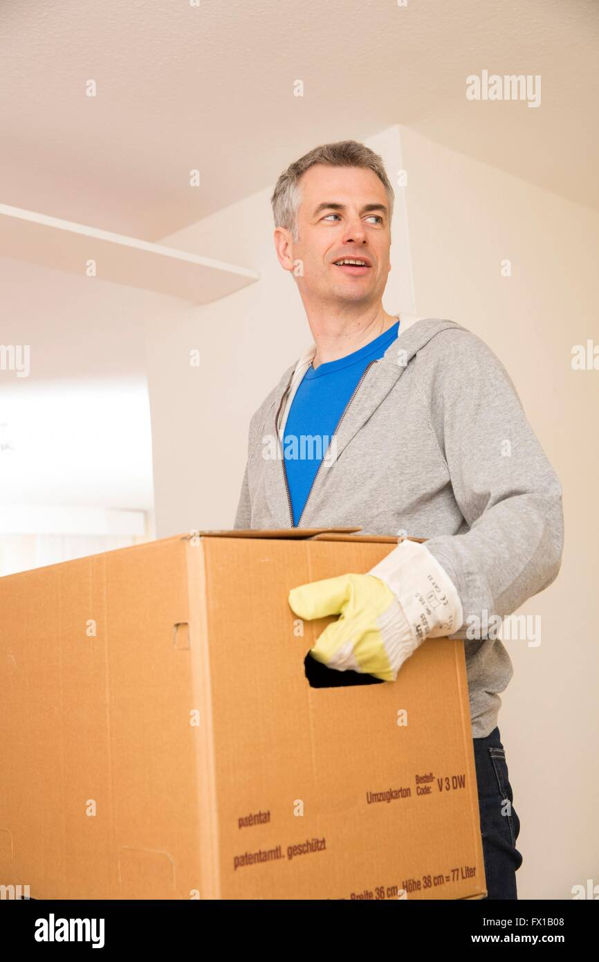 Move assistant carries a box - Stock Image