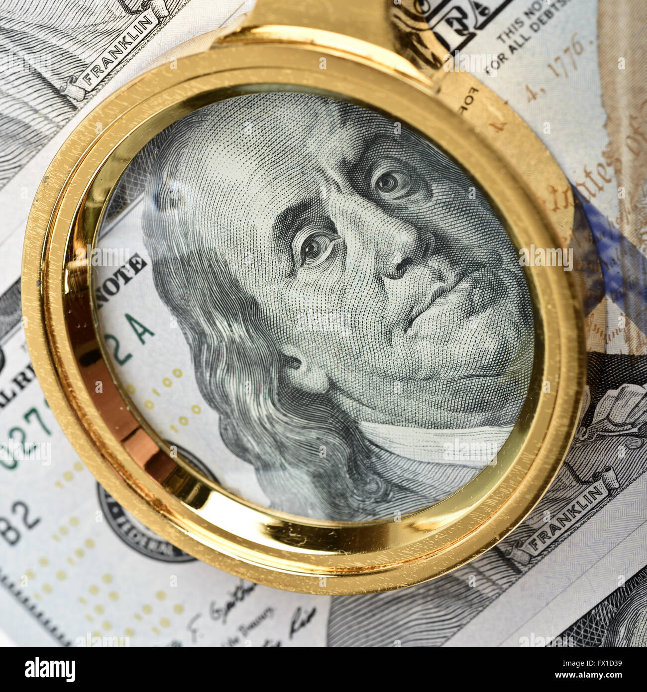 Magnifying Glass on the Franklin hundred dollars - Stock Image