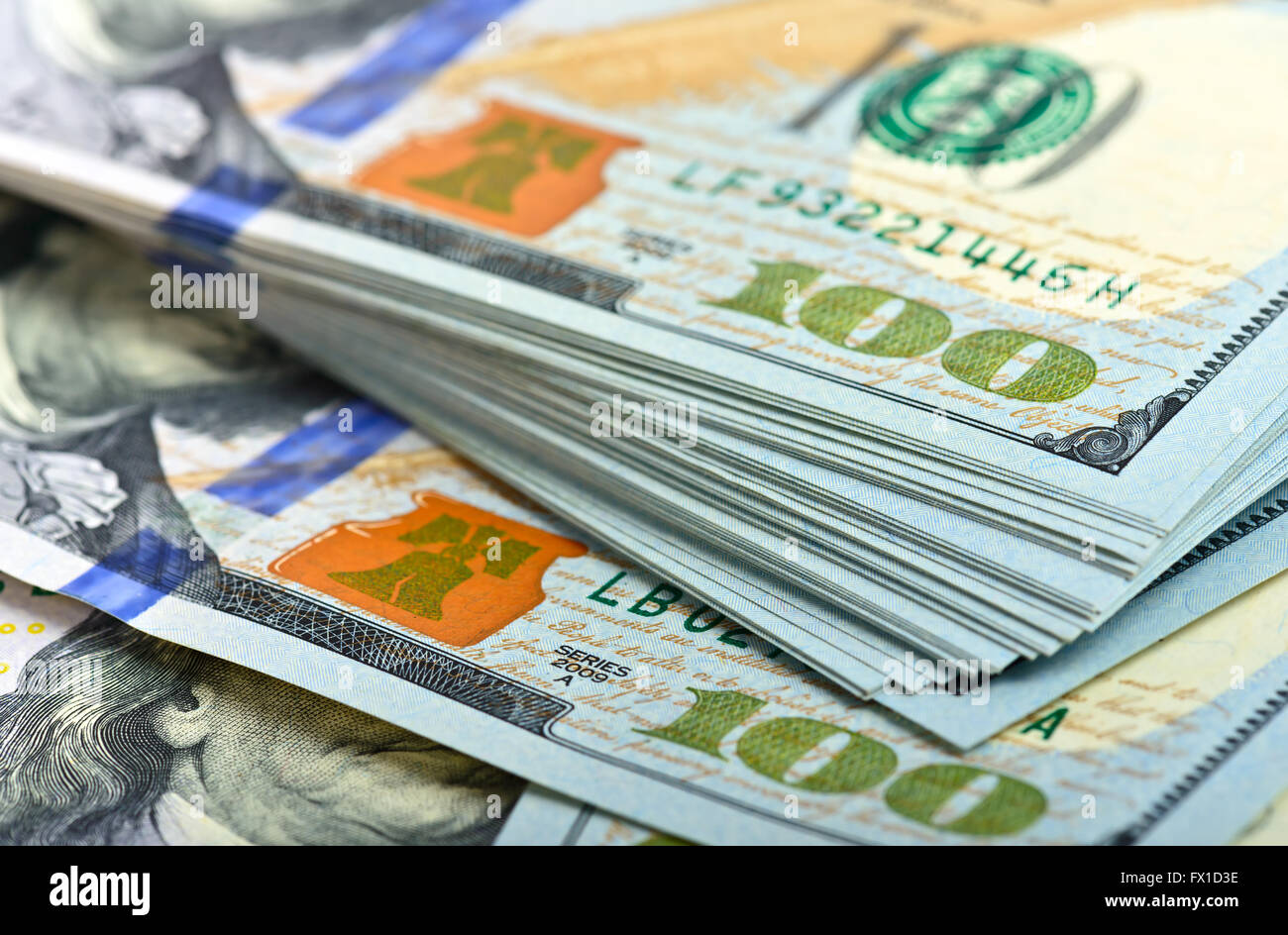 Stack of one hundred dollar bills close-up - Stock Image