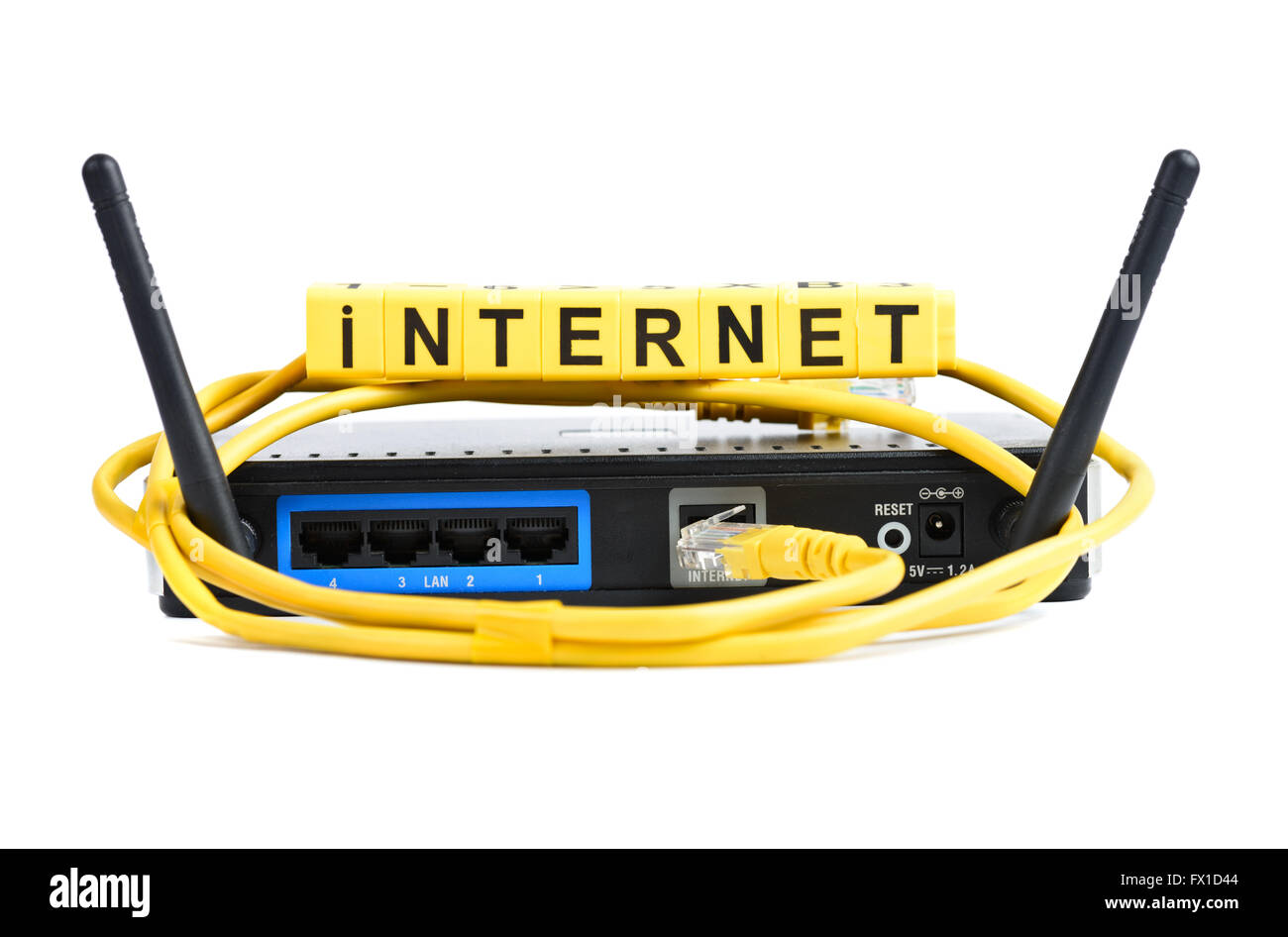 Network yellow cable and router or modem - Stock Image