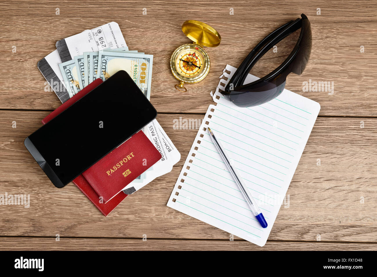 travel stuff on wooden table, top view - Stock Image