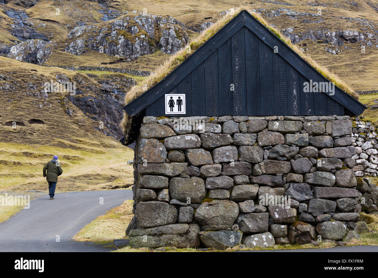 Grass roofed toilet conveniences at Saksun ancient village, Streymoy, Faroe Islands in April - Stock Image