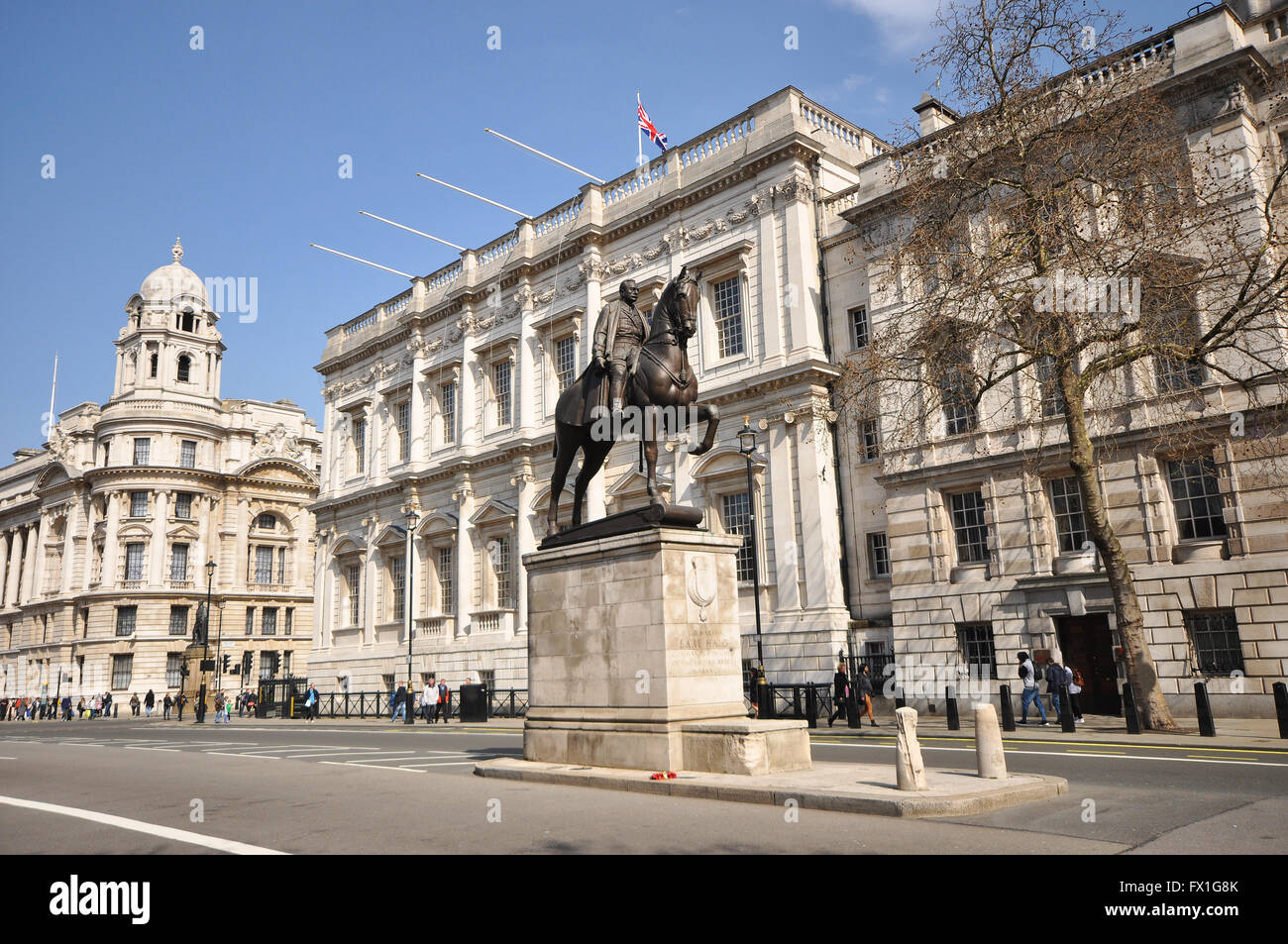 Whitehall, London. War Office to the left, Banqueting House centre rear and Earl Haig Memorial foreground. Space - Stock Image