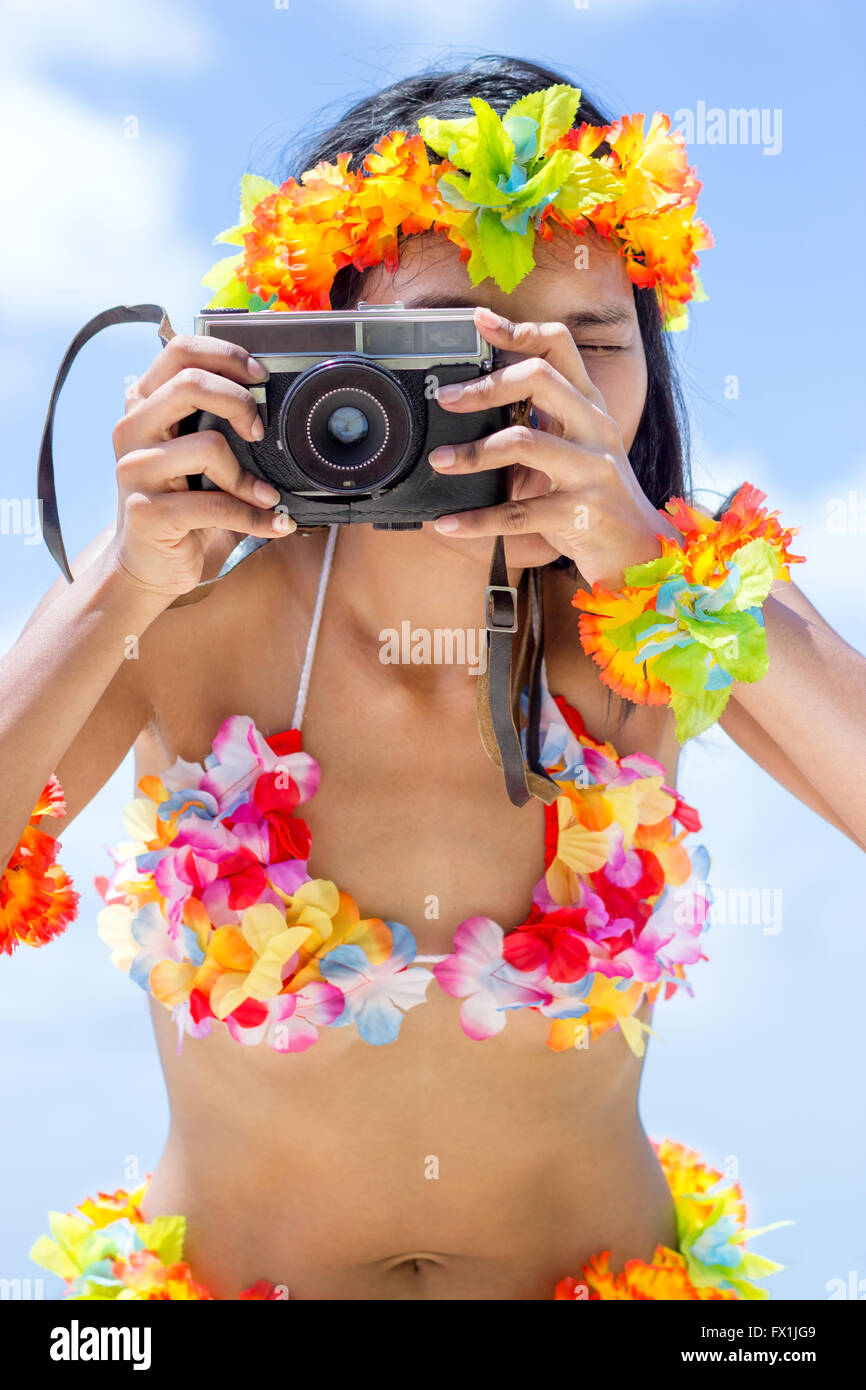 Hawaii hula dancer makes photo - Stock Image