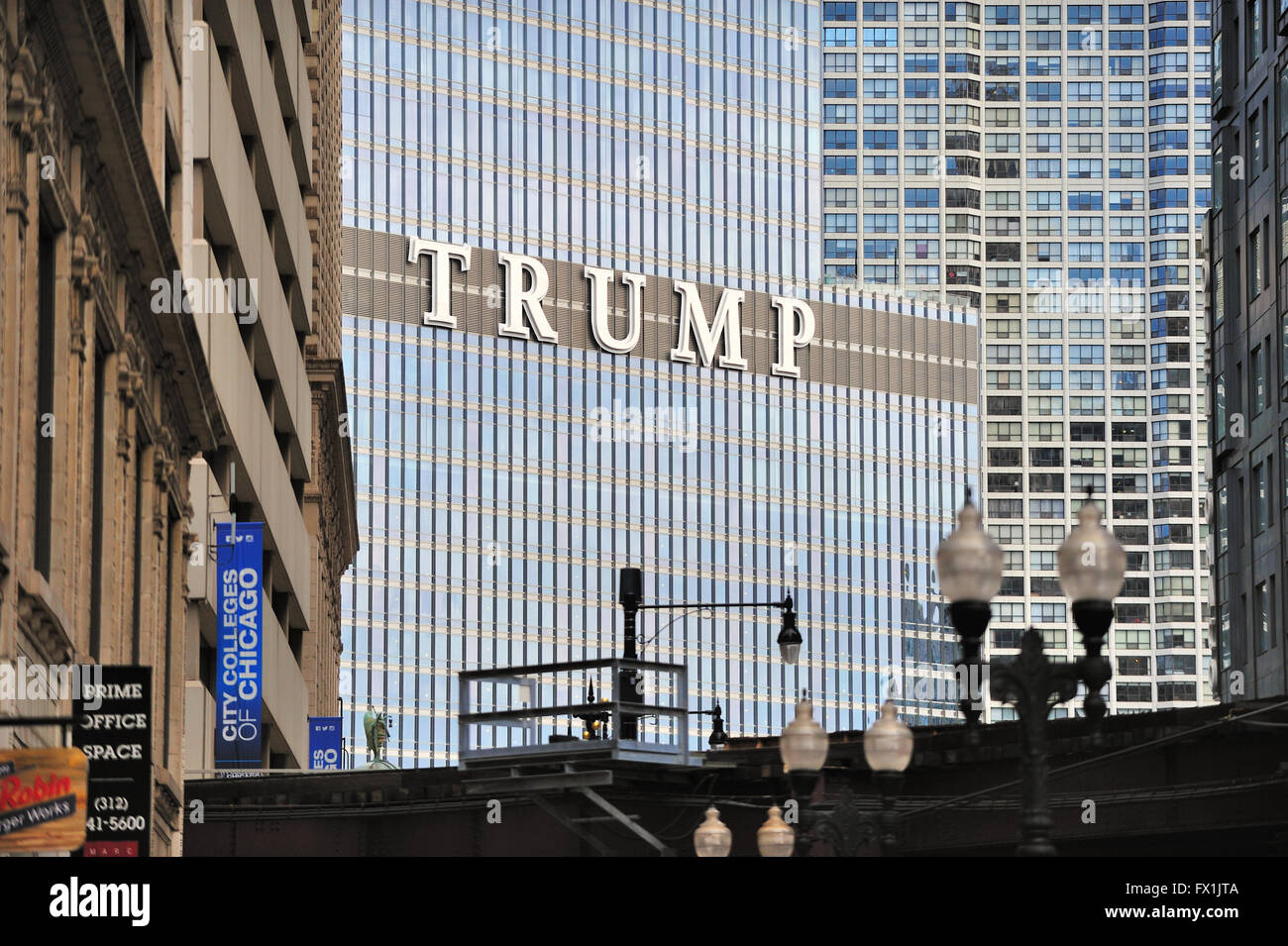 Chicago's second tallest skyscraper, Trump Tower, as viewed through older buildings that form a canyon above - Stock Image