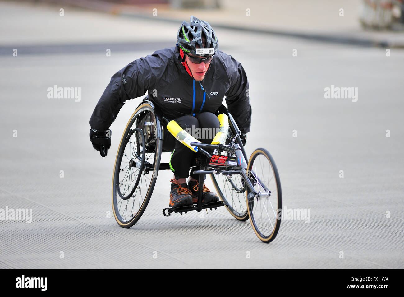Wheelchair athlete at about the one mile point of Chicago's Shamrock Shuffle race. Chicago, Illinois, USA. - Stock Image