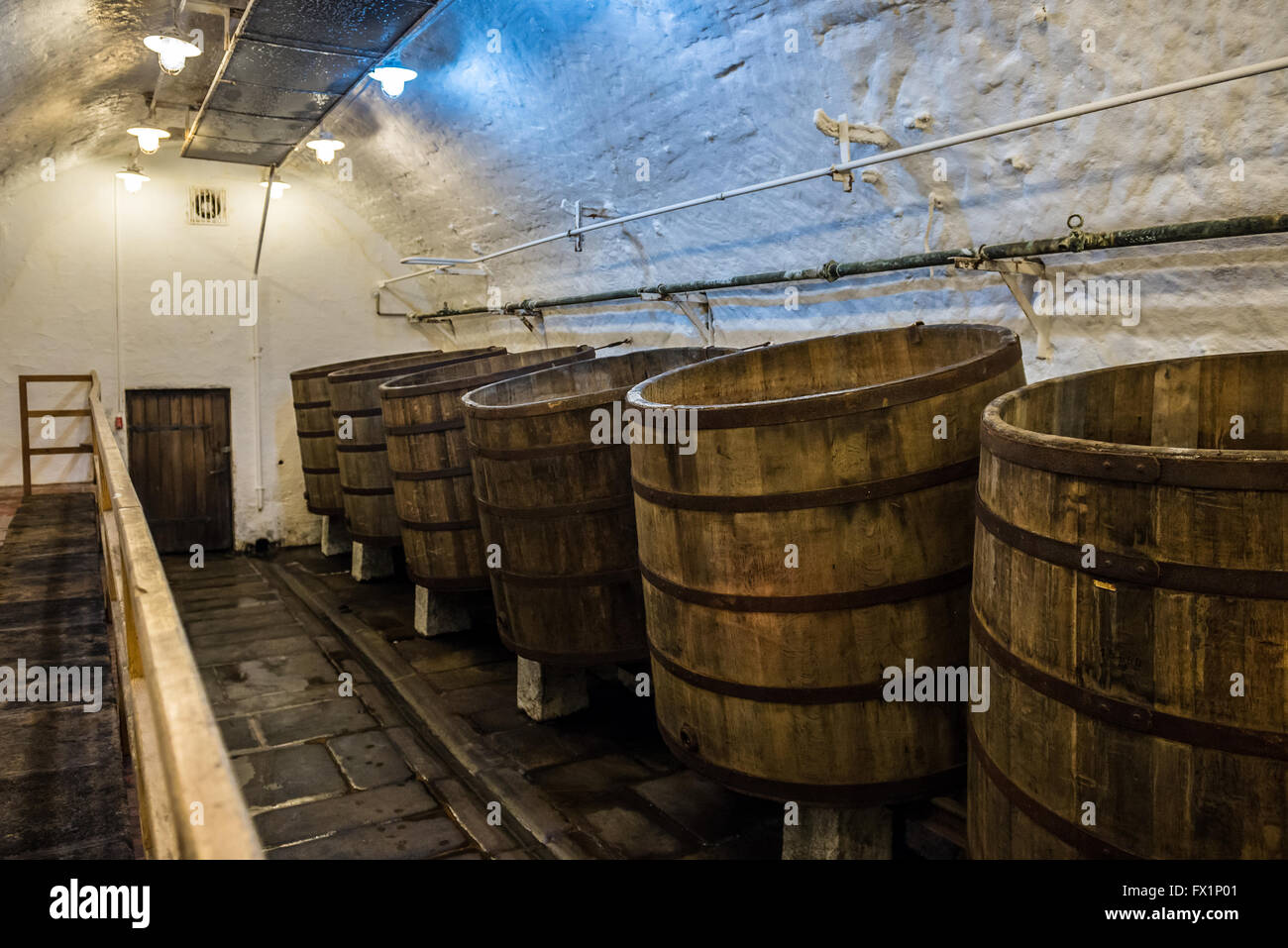 Wooden open fermentation barrels in the historical cellars of Pilsner Urquell Brewery in Pilsen city, Czech Republic - Stock Image