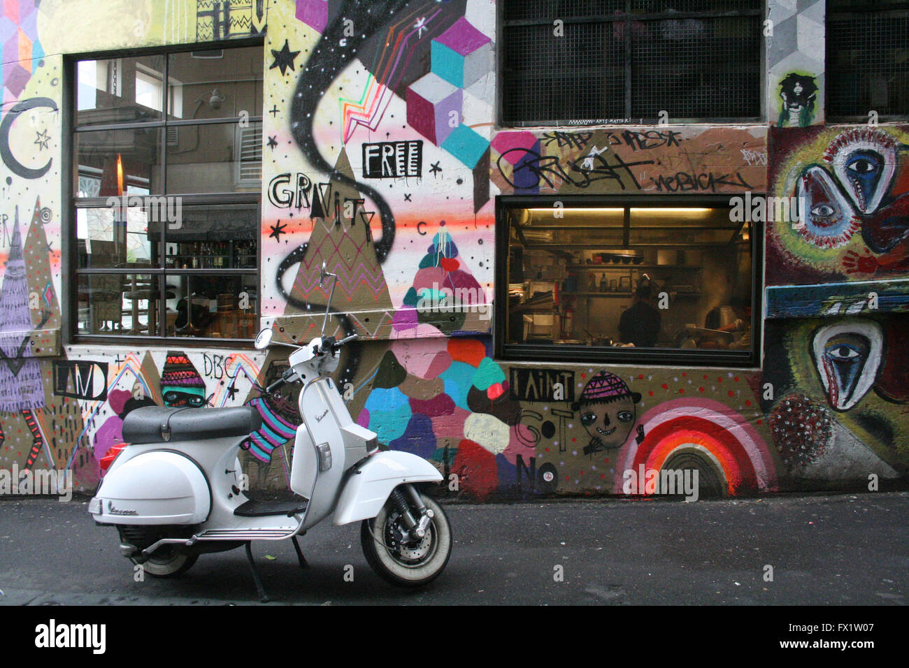 White Vespa Scooter Parked In Melbourne S City Laneway With Street