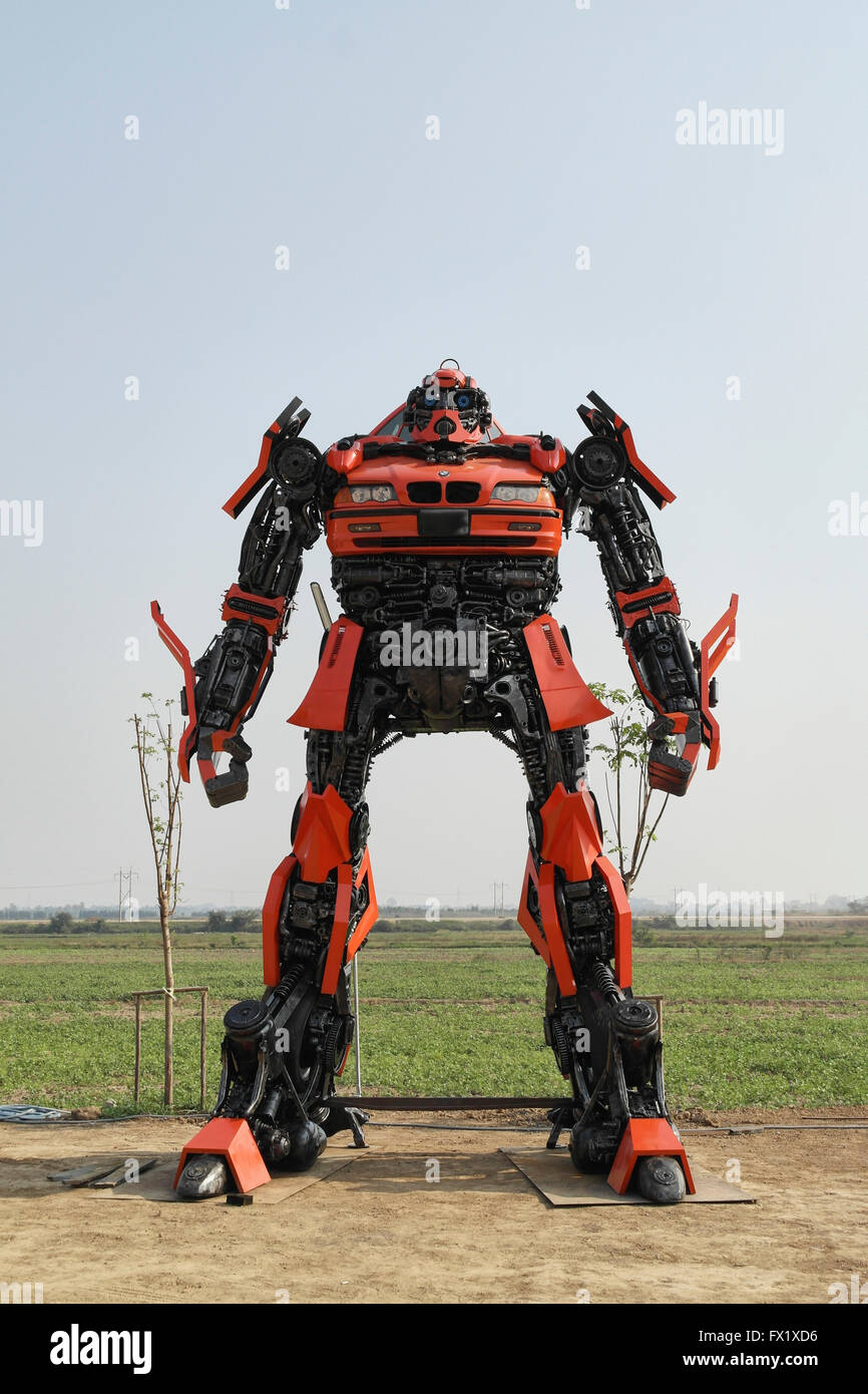 Thai artist buit the Transformers statue with old car parts - Thailand Stock Photo
