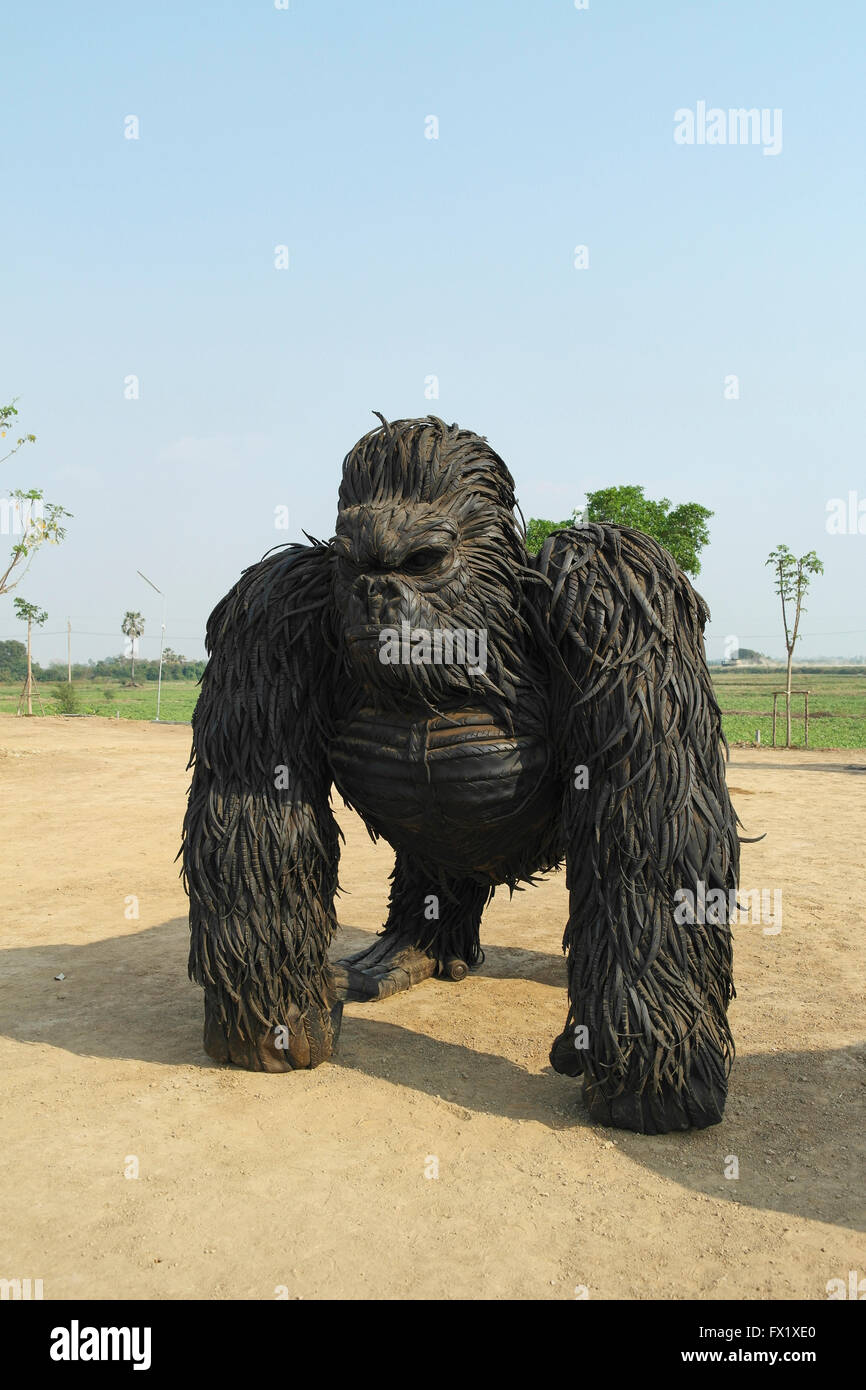 Gorilla statue made from old car wheels from an artist in Thailand - Thailand Stock Photo