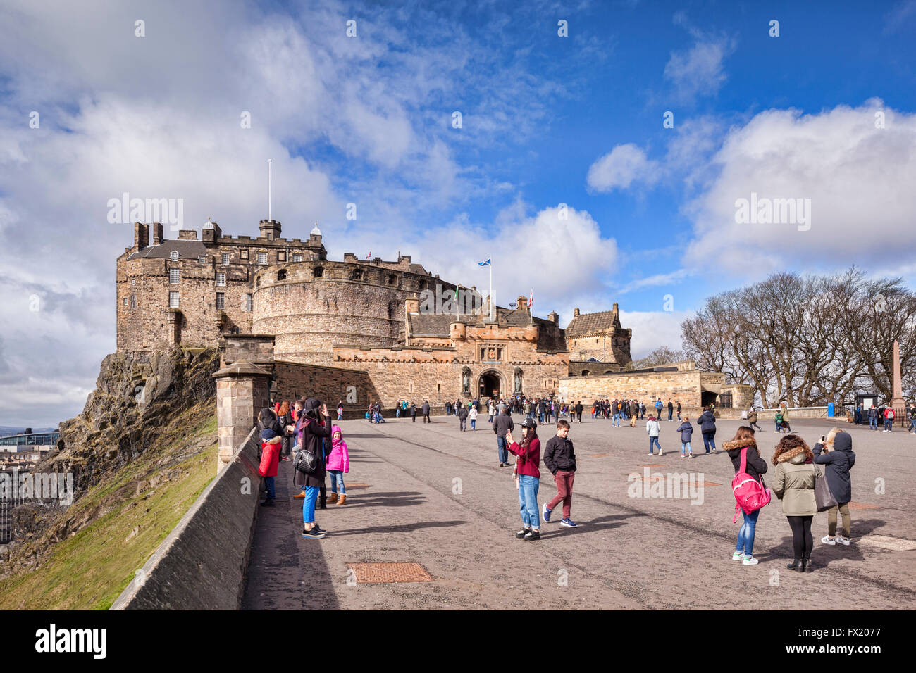 Tourists in the forecourt of Edinburgh Castle on a bright Spring day, Edinburgh, East Lothian, Scotland, UK Stock Photo