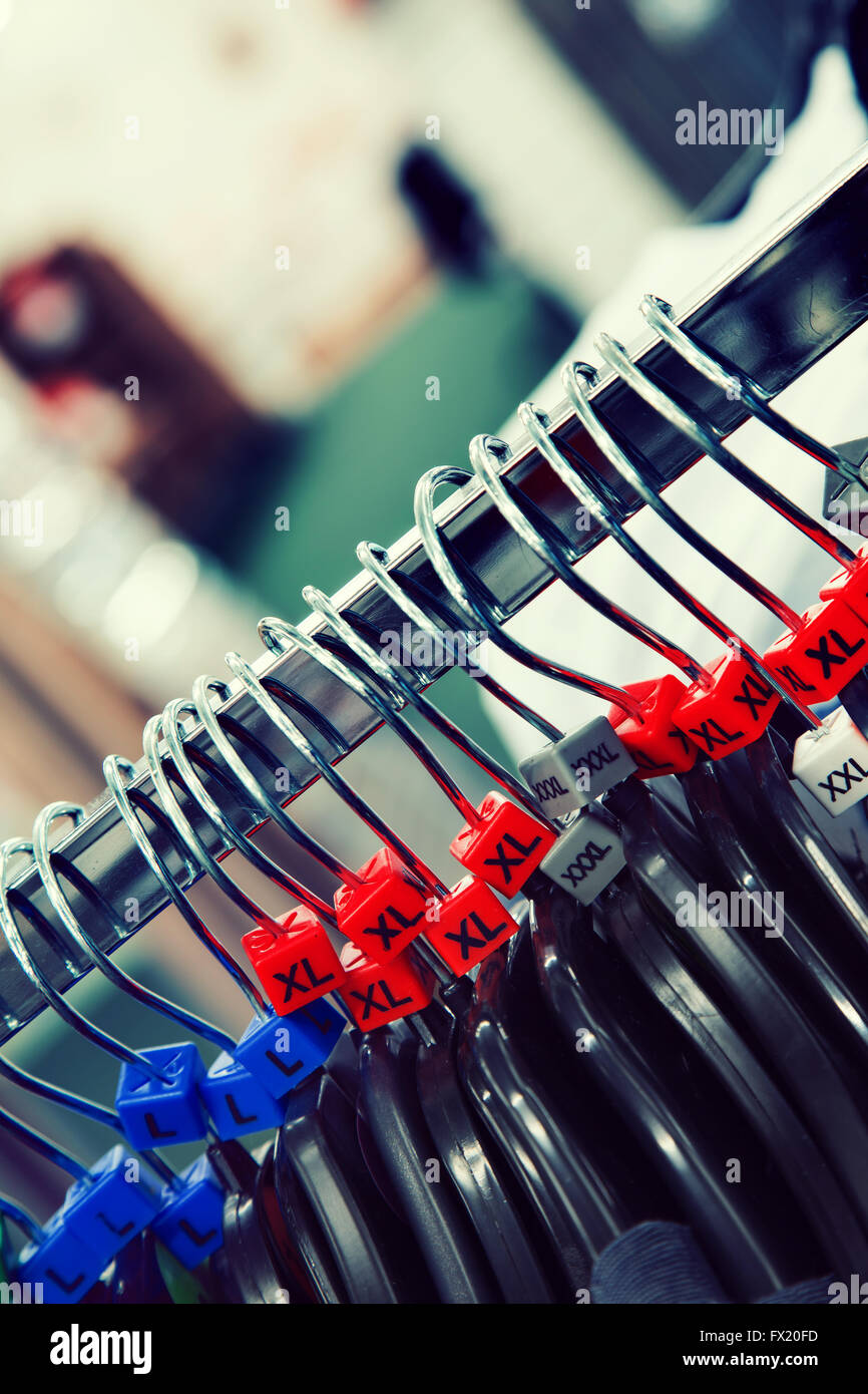 Sizes on clothes hangers - Stock Image