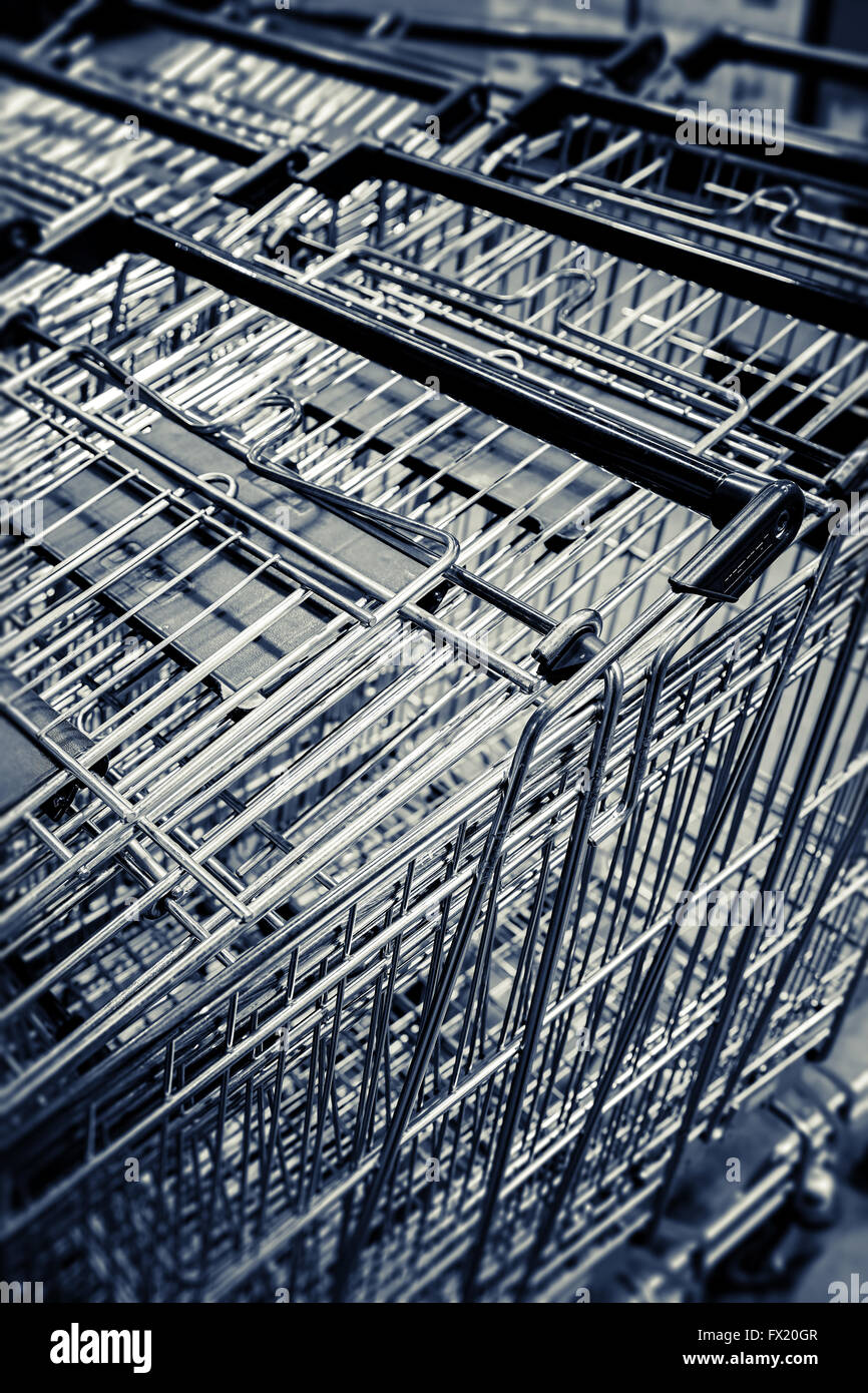 Supermarket basket trolleys - Stock Image